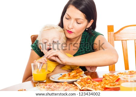 Young mother with child boy drinking juice, isolated on white background. - stock photo