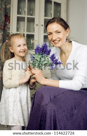 young mother with daughter at home - stock photo