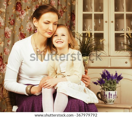 young mother with daughter at home white bright interior - stock photo