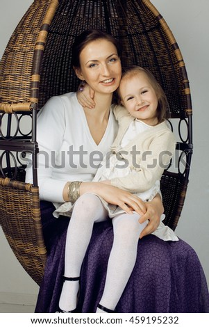 young mother with daughter at luxury home interior vintage - stock photo