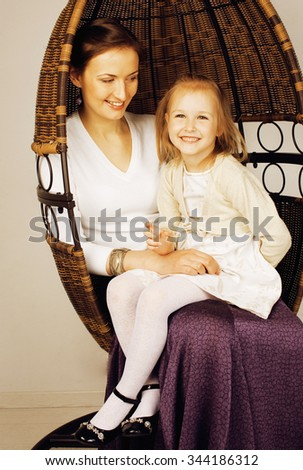 young mother with daughter at luxury home interior vintage hipster - stock photo
