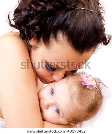 Young mother with her baby on white background