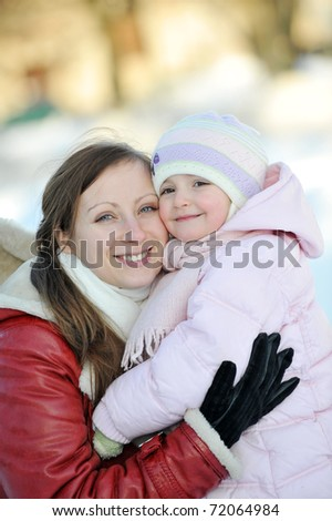 young mother with her daughter. winter day