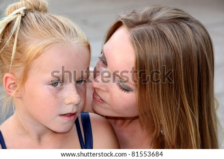Young mother with her little daughter - stock photo