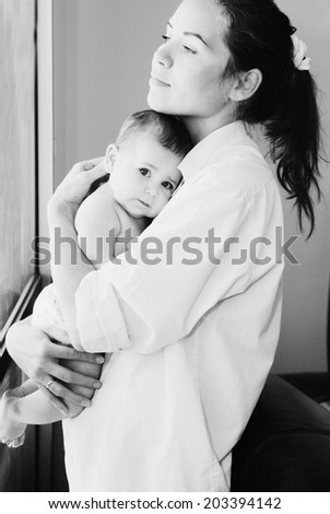 young mother with her 6 month old  baby