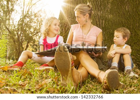 Young mother with kids - stock photo