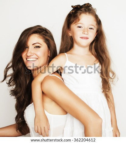 young mother with little cute daughter on white, happy smiling family inside isolated adorable girls - stock photo