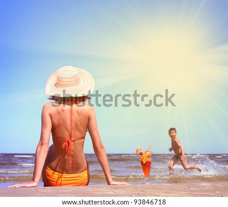 young mother with son on the beach