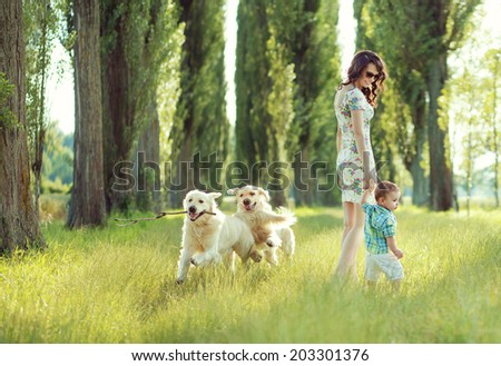 Young mother with toddler and dog  - stock photo