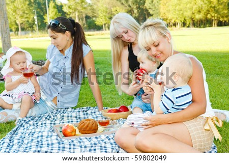 Young mothers with their baby kids - stock photo