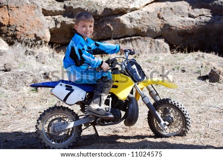 Young Motorcross Rider in the Desert - stock photo