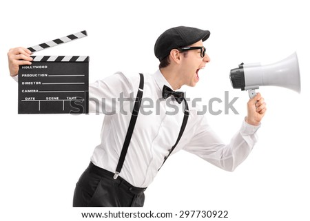 Young movie director holding a clapperboard and shouting on a megaphone isolated on white background - stock photo