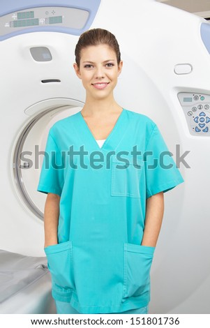 Young MTA in front of MRI machine in radiology in a hospital - stock photo