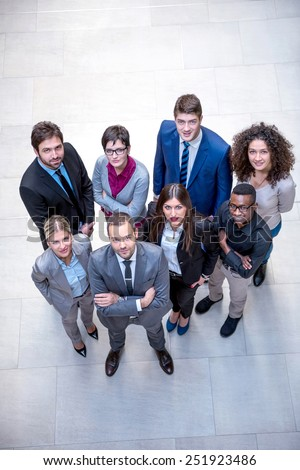 young multi ethnic business people group walking standing and top view - stock photo