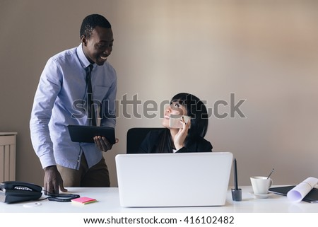 Young Multi-Ethnic Couple Working at the Office. - stock photo