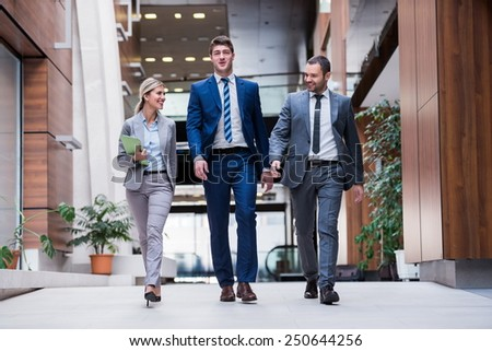 young multiethnic business people group walking - stock photo