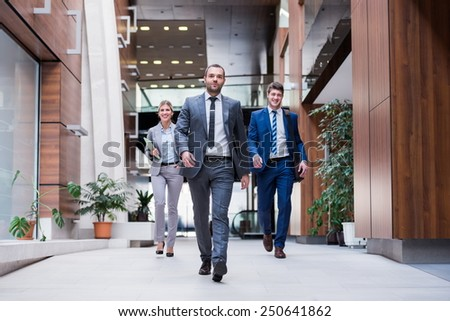 young multiethnic business people walking - stock photo