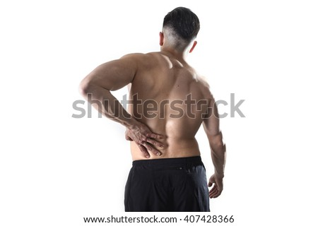 young muscular body sport man holding sore low back waist massaging with his hand suffering pain in athlete stress and health care concept isolated on white background - stock photo