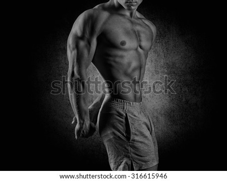 young muscular guy in the studio, posing for the camera