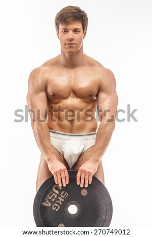 Young muscular guy with weights on white background - stock photo