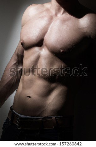 Young muscular man's torso - stock photo