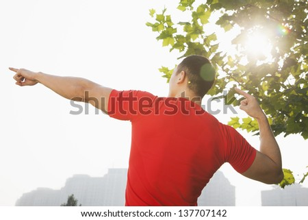 Young Muscular Man Stretching - stock photo