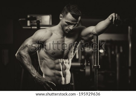Young Muscular Men Resting After Exercises - Portrait Of A Physically Fit Young Man Without A Shirt - stock photo