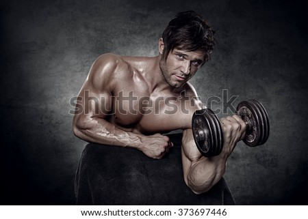 young muscular sexy man workout in gym - biceps closeup - stock photo