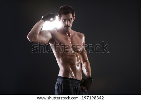 Young muscular sports guy with a naked torso boxing - stock photo