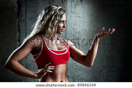Young muscular sports woman portrait. - stock photo