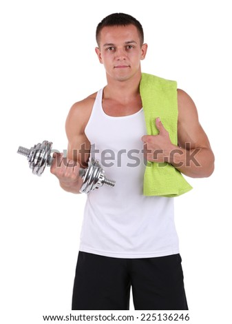 Young muscular sportsman with dumbbell and towel isolated on white - stock photo