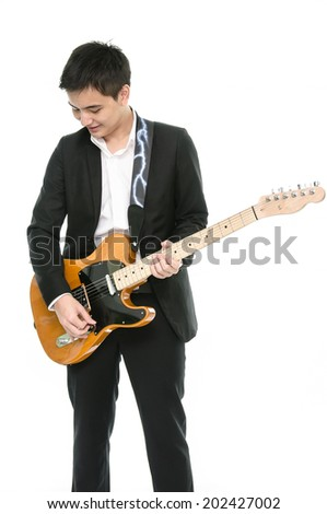 young musician is playing guitar - stock photo