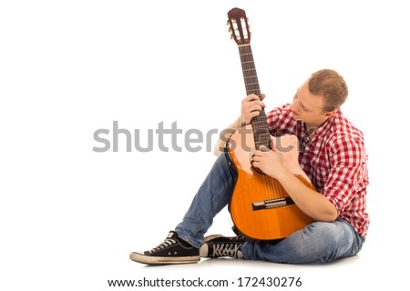 Young musician with wooden guitar - stock photo