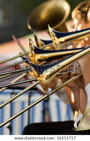 young musicians are playing on trombones - stock photo