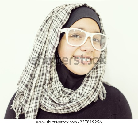 Young Muslim Arabic female in head scarf with modern clothes - stock photo
