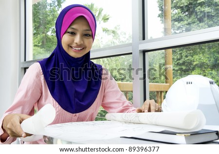 Young Muslim architect-woman in the office - stock photo