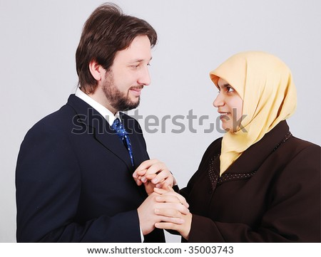 Young muslim couple looking at each other - stock photo