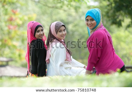 young muslim woman in head scarf meet friends in the park - stock photo