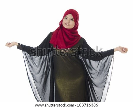Young Muslim woman in head scarf with modern clothes. - stock photo