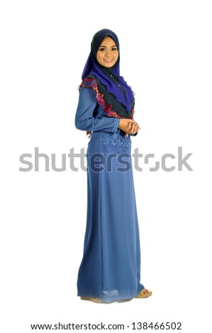 Young Muslim woman in head scarf with modern clothes, isolated on white - stock photo