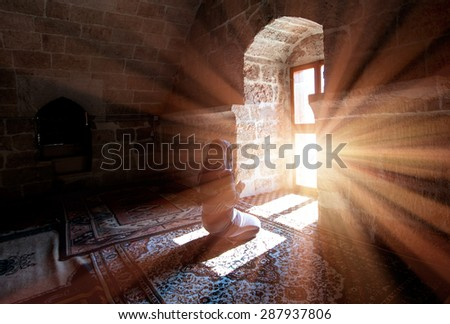 Young Muslim Woman Praying In Mosque - stock photo