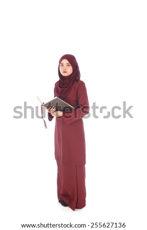 Young muslim woman read Hadith in the white background - stock photo