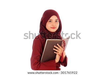 Young muslim woman read Quran with tasbih in the Ramadan time.                                - stock photo