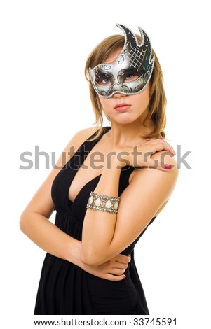Young mystery woman standing in silver venetian mask