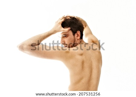 Young naked dancing man on a white background - stock photo