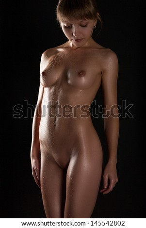Young naked girl in water droplets - stock photo