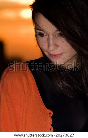 young natural looking woman portrait in sunset - stock photo