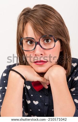 Young nerdy girl. Studio shot. - stock photo
