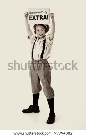 young newsboy holding up a newspaper - stock photo
