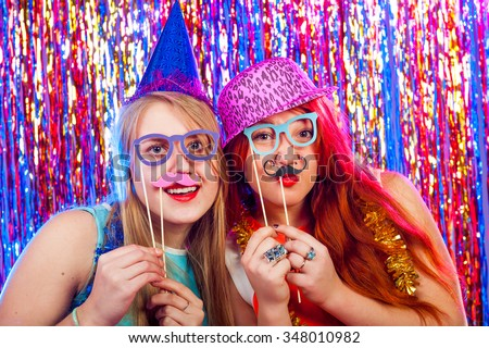 Young nice girls have fun on a dance party - stock photo